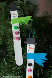 snowman popsicle stick ornaments glue sticks and gumdrops