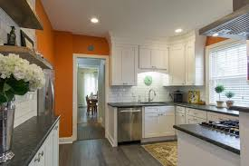 white kitchen cabinets orange walls bright transitional kitchen with orange accent wall and