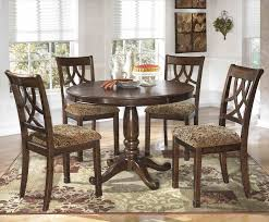 dining room furniture michigan furniture michigan piece round table set by signature design oval