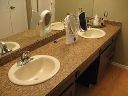 taking off an old bathroom laminate countertop and installing a