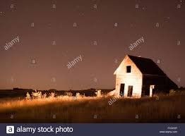 old ranch house at night in south dakota stock photo royalty free