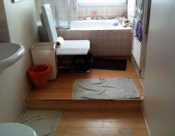 Solutions To A Wheelchair Users Difficulty Accessing Their Bath - Bathroom step