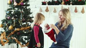 Mother Daughter Christmas Ornaments Mother And Daughter In Red Dresses Lie On The Floor Happy Small