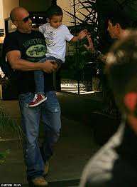 vin diesel shows his softer side as he hugs son vincent in photo