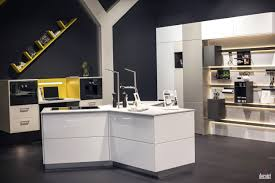 innovative yellow cabinets and counter gray backdrop floating open