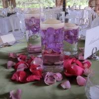 sand and candle centerpieces with stunning purple flower plus