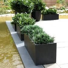outdoor tall brown metal rectangular planter box