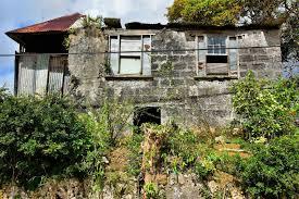 rundown concrete block house in saint andrew parish barbados