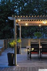 99 deck decorating ideas pergola lights and cement planters 62