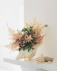 flower arrangement in a seashell flower arrangements flower and