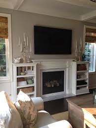 family room with sectional and fireplace fireplace with cabinets on either side house pinterest
