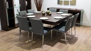 large square dark wood dining table glass legs 6 8 quilted chairs