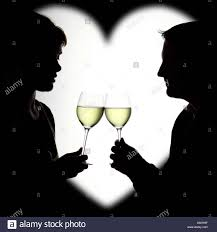 wine silhouette silhouette of a couple enjoying white wine framed in a heart stock