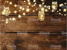 Mason Jar String Lights Horizontal Wooden Background With String Lights And Jars Stock