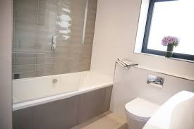 bathroom frameless shower door with duravit toilet and lowes tile