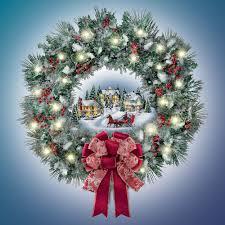 the kinkade illuminated wreath hammacher schlemmer
