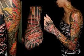 hand neck phoenix sleeve tattoo by javier tattoo