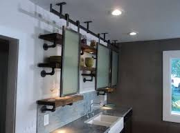 few vintage or industrial looking pipe shelves could suit a