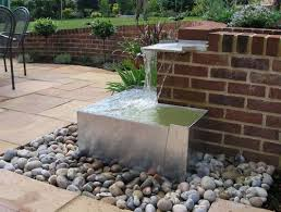exquisite small water features following unusual small interior
