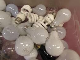 lot detail oodles of light bulbs box full of various sizes
