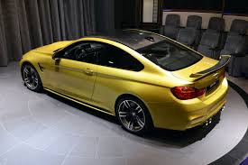 nissan gtr vs bmw m4 austin yellow m4 arrives at bmw abu dhabi motors 30 pics