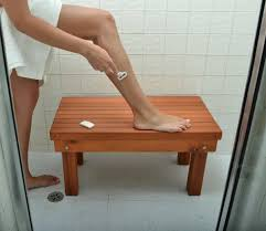 beautiful human leg on wood bench for diy shower bench with white