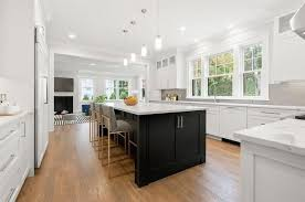 kitchen with black island and white cabinets custom cabinets for kitchens and bathrooms shore ma