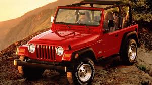 standard jeep wrangler jeep wrangler red on top of mountain