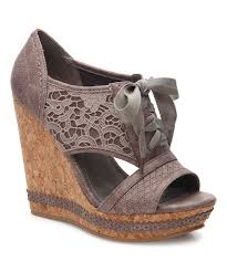this towering sandal flaunts delicate lace accents and a sturdy