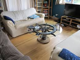 upcycled helm coffee table coffee ship wheel and house
