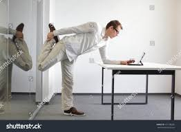 leg exercise durrng office work standing stock photo 151138265