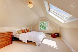 White And Beige Bedroom Attic Modern Bedroom With White Bed And Skylight And Beige Walls