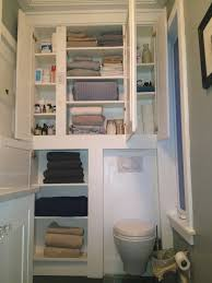 Bathroom Shelving Ideas For Towels White Wooden Towel Cabinet Over Toilet In Gray Painted Bathroom