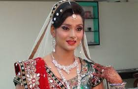 indian bridal makeup and hairstyle off white gold and green