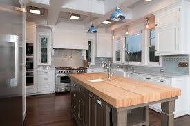 kitchen with butcher block island butcher block island for traditional kitchen with white cabinets