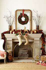 decorating a mantel for fall and christmas how to decorate for christmas add a larger wreath with a red ribbon and your stockings