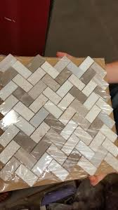 kitchen lowes backsplash in beige and grey herringbone wall tile