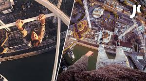 british man records pov video as he climbs a tower crane