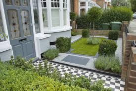landscape design for small spaces brick fence white pebbles