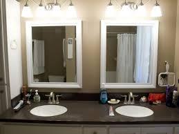 bathroom brown bathroom vanities gray wall lamp white bathtubs