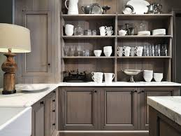 kitchen brown base cabinets gray benches brown tile flooring