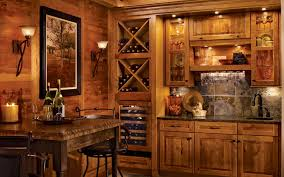 rustic kitchen cabinets by kraftmaid with stacked bottle storage