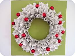 christmas wreath out of newpaper and a few ornament balls