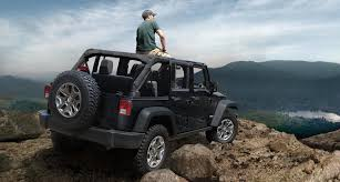jeep with surfboard why you should explore in a jeep this summer glendora chrysler