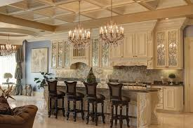 furniture quartz countertop with custom kitchen island and wood crystal chandeliers with coffered ceiling and white kitchen