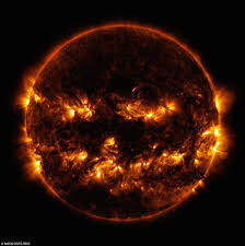images of a jack o lantern on the surface of the sun revealed by