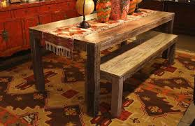 tribal pattern area rug and distressed dining table with bench set