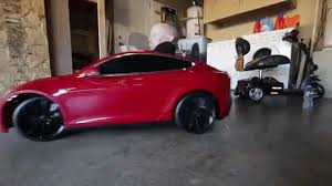 verne troyer unboxes and drives mini tesla model s