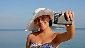 Hawaii travel man images Man taking pictures with smart phone of woman on beach on hawaii jpg