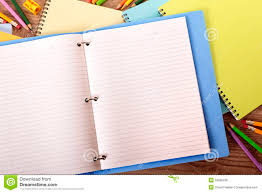 writing on lined paper student desk blank lined paper writing book ring binder copy space royalty free stock photo
